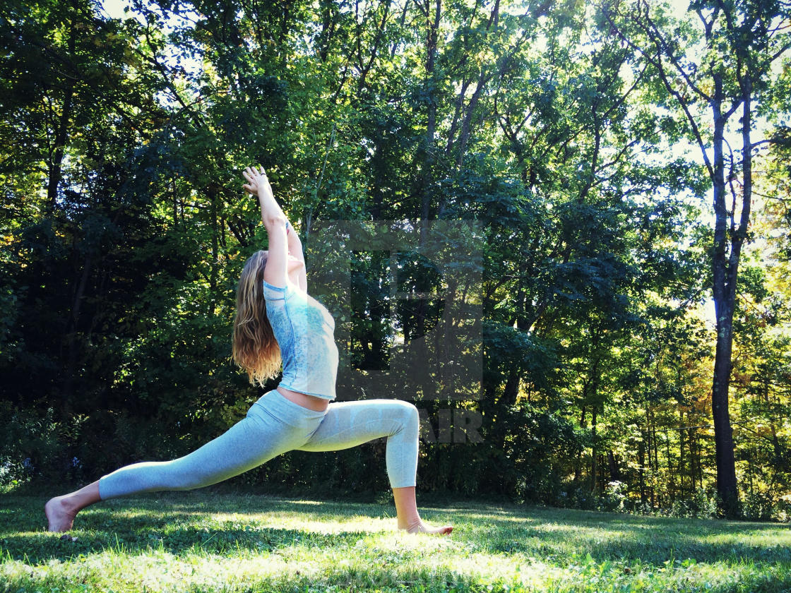 vinyasa yoga on the lawn at Slieve Aughty Centre
